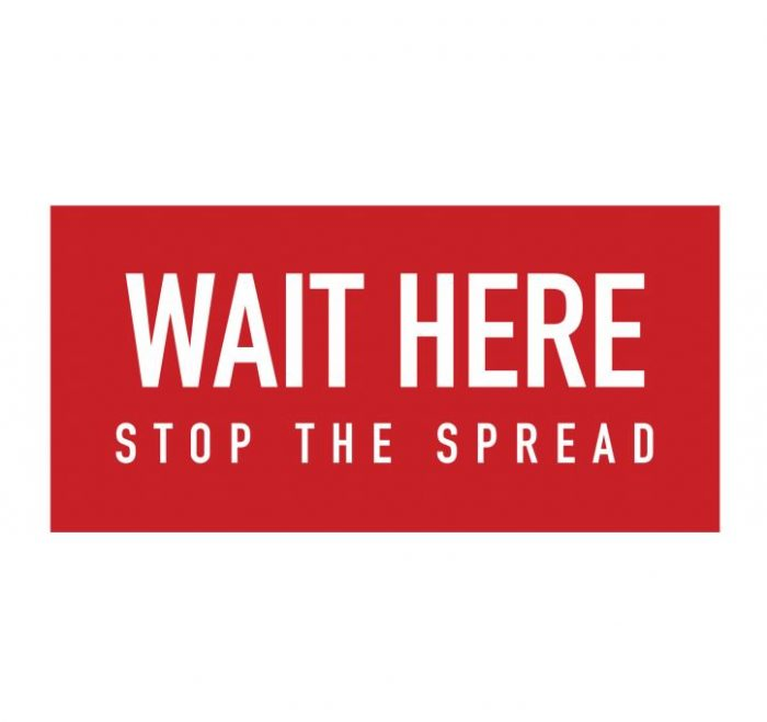 "floor graphic ""wait here stop the spread"""